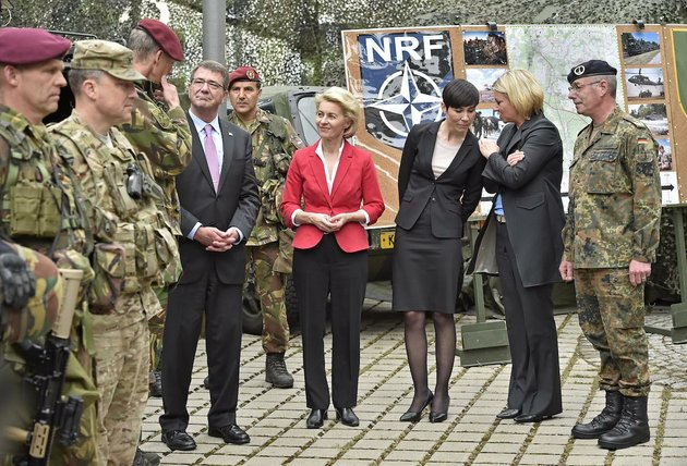us-secretary-of-defense-ash-carter-and-the-minsters-of-defense-ursula-von-der-leyen-germany-ine-eriksen-soreide-norway-and-jeanine-hennis-plasschaert-netherlands-from-left-talk-to-nato-response-force-soldiers-during-their-visit-to-the-i-german-dutch-brigade-in-muenster-germany-monday-june-22-2015-the-troops-are-part-of-natos-very-high-readiness-joint-task-force-vjtf