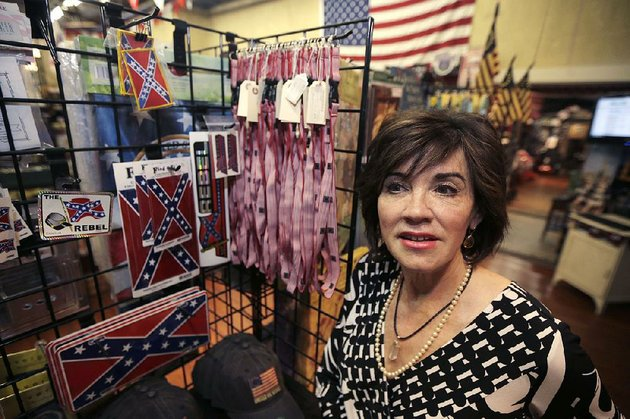 kerry-mccoy-stands-in-arkansas-flag-and-banner-in-little-rock