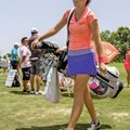 Kristi O'Brien walks off the driving range Tuesday at Pinnacle Country Club in Rogers during practic...
