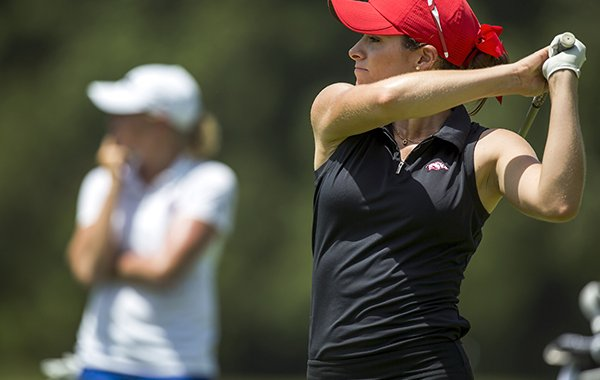 Razorback golfer Gaby Lopez hits from the fifth tee box with former Razorback golfer Stacy Lewis (left) on Tuesday, June 23, 2015, at Pinnacle Country Club in Rogers during practice rounds for the Walmart NW Arkansas Championship.