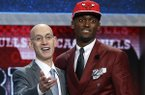 Bobby Portis, right, poses for photos with NBA commissioner Adam Silver after being selected 22nd overall by the Chicago Bulls during the NBA basketball draft, Thursday, June 25, 2015, in New York. (AP Photo/Kathy Willens)