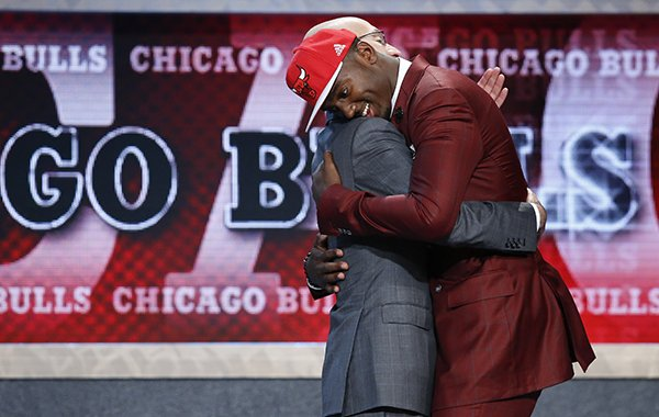 Bobby Portis, right, hugs NBA Commissioner Adam Silver after being selected 22nd overall by the Chicago Bulls during the NBA basketball draft, Thursday, June 25, 2015, in New York. (AP Photo/Kathy Willens)