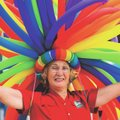 Roxie Howard of Eureka Springs wears a balloon wig Saturday during the NWA Pride Parade on Dickson S...