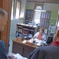 Henry Byers, left, and Dennis Leonard wait Saturday while Deputy County Clerk Sherry Cochrane fills ...