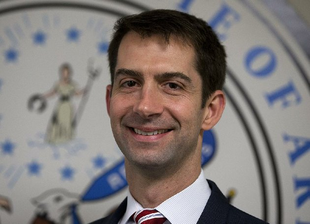sen-tom-cotton-r-ark-arrives-to-pose-for-photographers-in-his-office-on-capitol-hill-in-washington-wednesday-march-11-2015