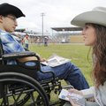 Alex Munoz (left) visits Thursday with Tori Miller, 2014 Rodeo of the Ozarks queen, before receiving...