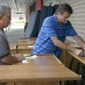 Jim Pelfrey (left) and Richard Huggins place name tags Tuesday on furniture at LifeSource in Fayette...