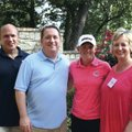 Stacy Lewis, second from right, stands with hosts Susan and Mike Moore (from right) and Alex Perwich...