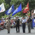 Veterans fly flags from branches of the U.S. military Saturday to start the Fourth of July Patriot P...