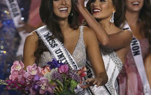 Paulina Vega of Colombia (left) is crowned Miss Universe by then-reigning Miss Universe Gabriela Isler in Miami in this January file photo.