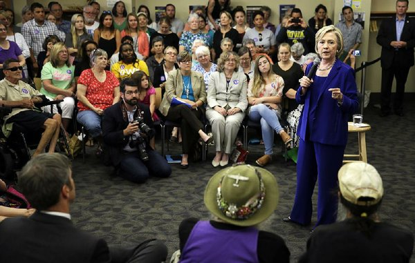 clinton urges fair shot for debthit puerto rico