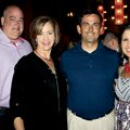 Tim and Mary Beth Brooks (from left) visit with James and Angie Graves at the 11th annual Red, White...