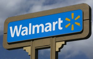 FILE - This May 28, 2013 file photo shows a sign outside a Wal-mart store in Duarte, Calif.