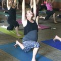 Community members  participate in a summer yoga class July 13 at the Fayetteville Public Library.