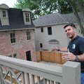 Juan Quiros shows two homes June 26 he and his crew have built in downtown Bentonville, in conjuncti...