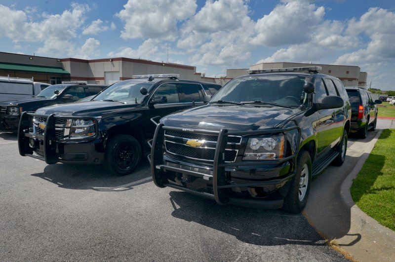 New Chevrolet Tahoe patrol vehicles sit on the lot at the Benton County Sheriff's Office in Bentonville. The Sheriff's Office introduced a black Chevrolet ...