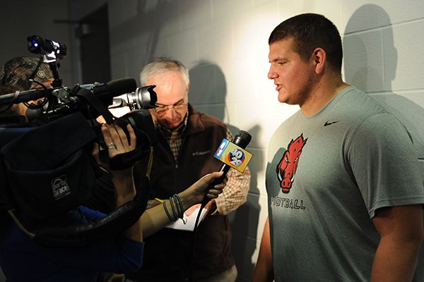 Lineman Zach Rogers speaks to members of the media Monday, Dec. 22, 2014, during a press conference ahead of the Razorbacks' Dec. 29 bowl game with Texas in Houston.