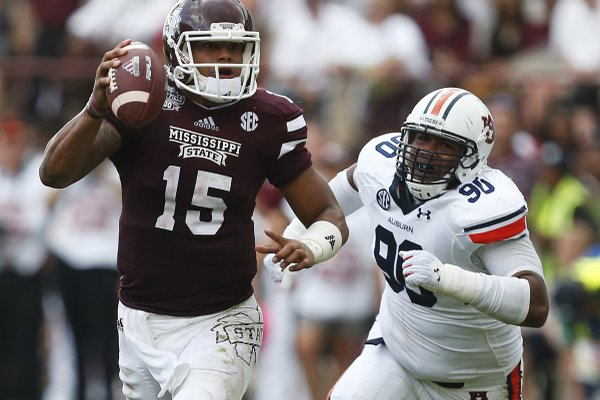 The return of all-conference quarterback Dak Prescott (15) and the experience of other returnees should be enough to overcome having only eight returning starters, Mississippi State Coach Dan Mullen said.
