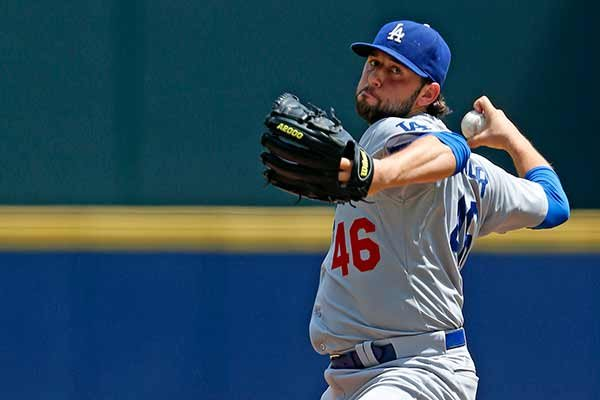 Los Angeles Dodgers starting pitcher Mike Bolsinger (46) pitches against the Atlanta Braves during the first inning of a baseball game, Wednesday, July 22, 2015, in Atlanta. (AP Photo/Butch Dill)
