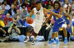 Bentonville's Malik Monk, (5) dribbles around North Little Rock's Kambrion Dickerson (12) during the Class 7A Boys State High School Basketball Championships in Hot Springs on Saturday, March 14, 2015.