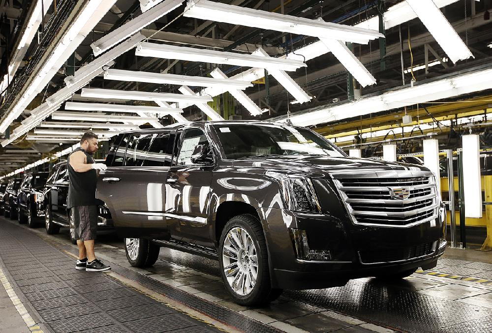 an assembly line worker inspects a cadillac escalade earlier this. Cars Review. Best American Auto & Cars Review