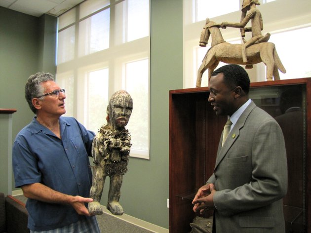 kevin-katz-left-and-philander-smith-college-president-roderick-smothers-right-show-members-of-the-media-a-sculpture-from-the-25-piece-collection-donated-to-the-school-by-katz-and-his-wife-melissa-at-the-schools-library-on-july-24-2015