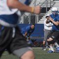 Joseph Sultemeier, Rogers High quarterback, looks for a receiver July 16 during the Mounties team ca...