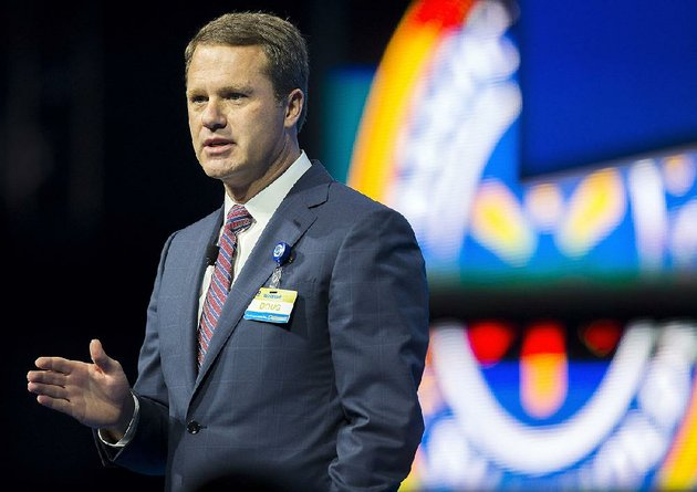 doug-mcmillon-chief-executive-officer-speaks-on-stage-during-the-annual-wal-mart-shareholers-meeting-on-friday-june-5-2015-at-bud-walton-arena-in-fayetteville