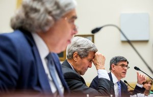 Secretary of State John Kerry (center) pauses Tuesday as he, Energy Secretary Ernest Moniz (left) and Treasury Secretary Jacob Lew testify before House members on the Iran nuclear agreement.