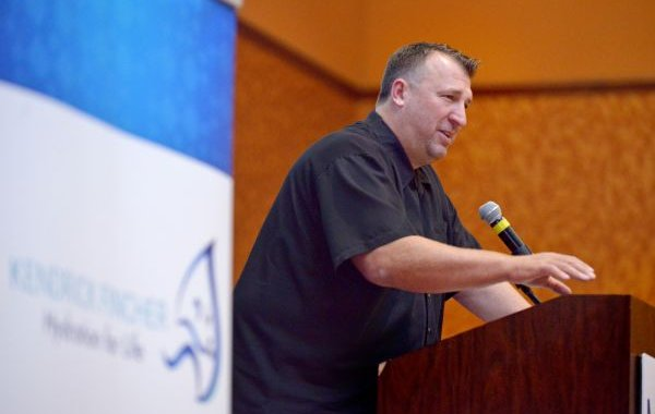 Bret Bielema, Arkansas head coach, speaks on Thursday, July 30, 2015, during the Mercy Coaching Summit at the John Q. Hammons Center in Rogers. Bielema highlighted hydration and player safety.