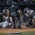 Naturals catcher Parker Morin falls after colliding with and tagging out Cardinals runner Patrick Wi...