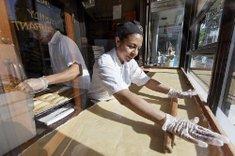 A baker works ...