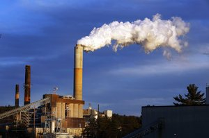 Steam billows from the coal-fired Merrimack Station in Bow, N.H., in January. President Barack Obama today will unveil the final version of his regulations clamping down on carbon dioxide emissions from existing U.S. power plants.