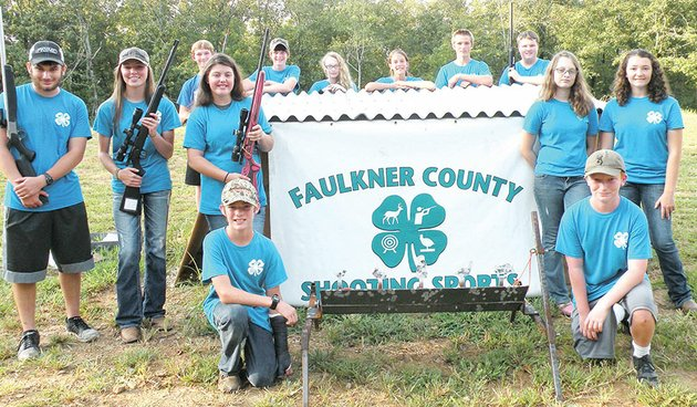 members-of-the-faulkner-county-4-h-shooting-sports-club-include-front-row-kneeling-from-left-dooley-huff-of-greenbrier-and-nick-massey-of-conway-second-row-alec-ohlde-of-conway-ali-verkler-of-conway-kadee-fason-of-guy-faith-palmer-of-greenbrier-and-bailey-smith-of-quitman-and-back-row-jesse-mcclellan-of-solgohachia-tommy-newsom-of-conway-makayla-palmer-of-greenbrier-julie-newsom-of-conway-auden-huff-of-greenbrier-and-cade-rowlett-of-guy-the-4-h-shooting-sports-club-is-an-educational-program-sponsored-by-the-faulkner-county-cooperative-extension-service-university-of-arkansas-division-of-agriculture