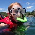 Kenlee Morris, 10, (left) explores the underwater world at Beaver Lake on Wednesday August 12 2015 d...