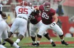 Arkansas center Mitch Smothers (65) blocks during a game against Alabama on Saturday, Oct. 11, 2014, at Razorback Stadium in Fayetteville.