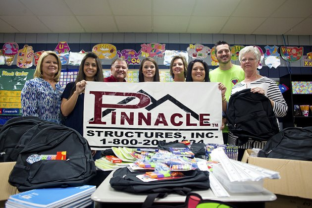 pinnacle-structures-and-arkansas-office-products-teamed-up-this-year-to-provide-backpacks-and-school-supplies-for-50-students-at-ward-central-elementary-school-from-left-are-charon-regnas-nicole-singleton-and-steven-pawloski-all-of-arkansas-office-products-nancy-bard-of-pinnacle-structures-dawn-verkler-principal-of-ward-central-elementary-courtney-jackson-of-pinnacle-structures-andy-sullivan-of-ward-central-elementary-and-pam-griffin-of-pinnacle-structures
