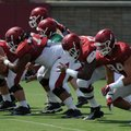 Members of the Arkansas offensive line — Mitch Smothers (from left), Sebastian Tretola, and Denver K...
