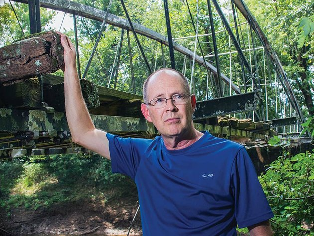 kenneth-barnes-a-member-of-the-faulkner-county-historical-society-heads-up-the-effort-to-save-the-springfield-des-arc-bridge-which-was-built-in-1874-on-the-north-branch-of-cadron-creek-which-separates-faulkner-and-conway-counties