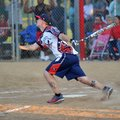 Kyle Earl, Wounded Warrior amputee softball player, connects Friday for a base hit during their soft...