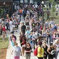 Fayetteville High School freshmen and parents cross the main courtyard area en route to class after ...