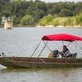 A member of the Benton County Dive/Rescue Team runs a search Monday in Lake Elmdale in Elm Springs f...