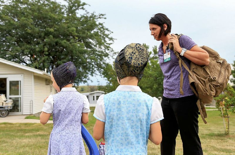nurse gains hutterites trust to aid colony