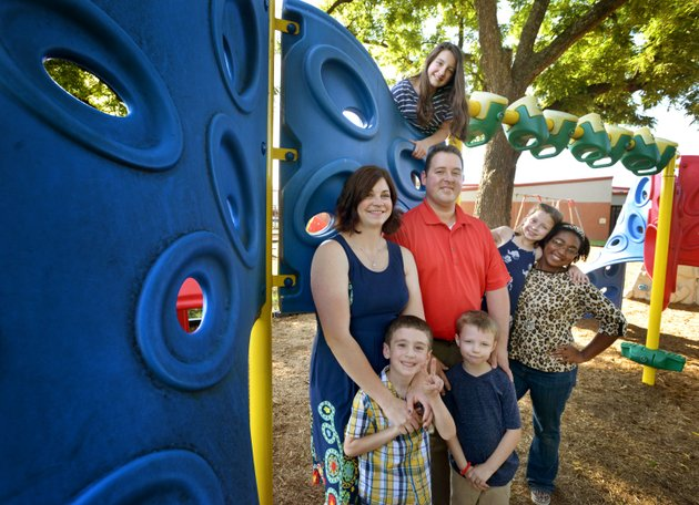 nwa-democrat-gazetteben-goffnwabengoff-the-meythaler-family-poses-for-a-photo-thursday-on-the-playground-at-sugar-creek-elementary-school-in-bentonville-the-family-includes-front-from-left-daniel-meythaler-5-david-meythaler-5-second-row-from-left-ann-meythaler-kerry-meythaler-kylie-meythaler-7-charlotte-meythaler-and-back-emily-meythaler-12-8220northwest-arkansas-doesn8217t-do-that-much-better-than-the-other-parts-of-the-state-in-recruiting-foster-families-the-difference-is-retention8221-said-ann-meythaler-benton-county-coordinator-for-the-call