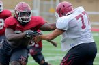 Hope defensive end McTelvin Agim (left) goes through practice on Thursday, Aug. 20, 2015, in Hope.