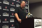 Bret Bielema speaks to reporters before addressing the Little Rock Touchdown Club on Monday Aug. 24, 2015.