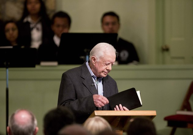 former-president-jimmy-carter-opens-up-a-bible-while-teaching-sunday-school-at-maranatha-baptist-church-in-plains-ga-in-this-aug-23-file-photo