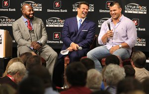 Felix Jones (from left) and David Bazzel laugh at a story told by Peyton Hillis at the Little Rock Touchdown Club luncheon in Little Rock on Monday, Aug. 31, 2015. All three played football for the University of Arkansas. Jones and Hillis, both former NFL players also, were the guest speakers and Bazzel was the host.
