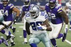 Dallas Cowboys' Darren McFadden (20) evades pressure from Minnesota Vikings' Tom Johnson (92) during a preseason NFL football game Saturday, Aug. 29, 2015, in Arlington, Texas. (AP Photo/Tony Gutierrez)