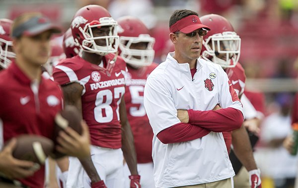 Arkansas offensive coordinator Dan Enos watches the team during warm-ups on Saturday, Sept. 5, 2015, before the Razorbacks' game against UTEP at Donald W. Reyonlds Razorback Stadium in Fayetteville.
